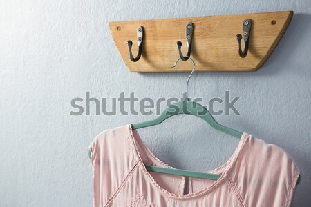 Close-up of warm clothes hanging on hook Stock photo © wavebreak_media