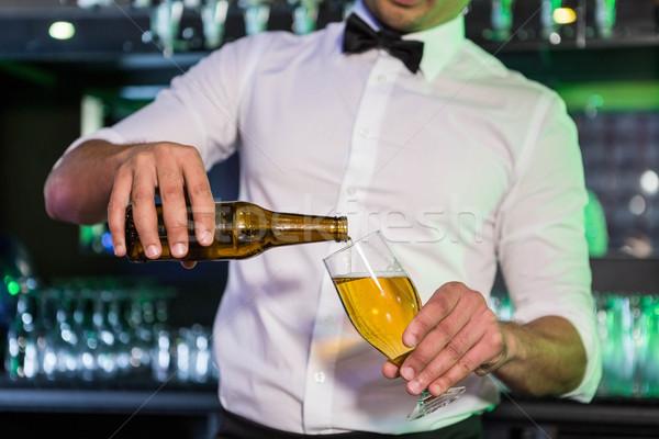 Barista birra vetro bar Foto d'archivio © wavebreak_media