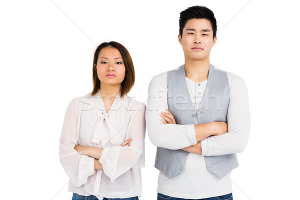 Upset couple standing with arms crossed Stock photo © wavebreak_media
