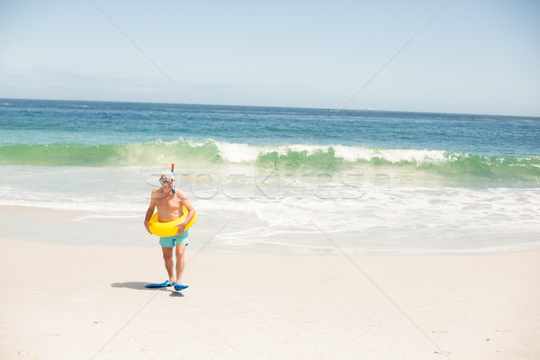 Senior man with swimming ring and flippers  Stock photo © wavebreak_media