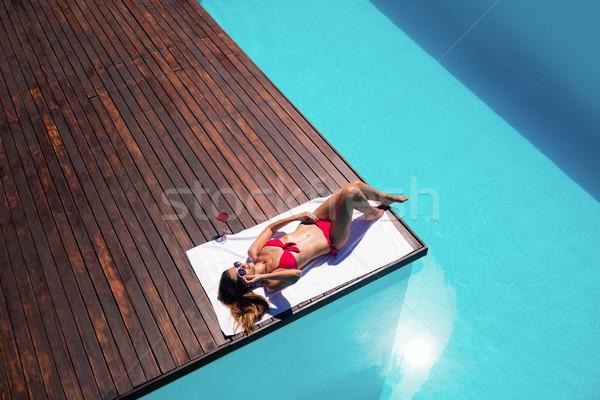 Nő élvezi medence perem napos idő otthon Stock fotó © wavebreak_media
