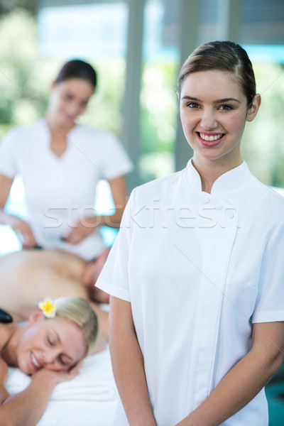 Portrait of happy female masseur in spa Stock photo © wavebreak_media