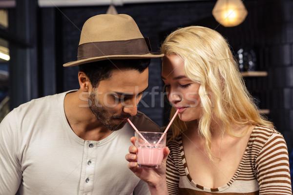 Couple sharing a milkshake Stock photo © wavebreak_media