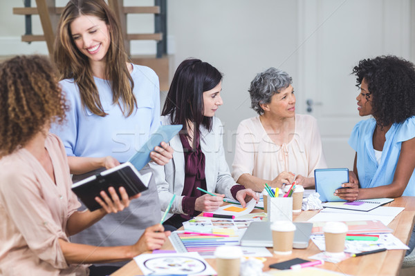Group of interior designers interacting with each other Stock photo © wavebreak_media