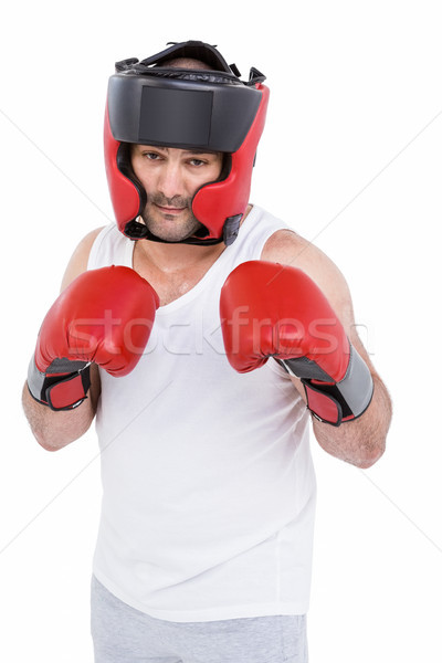 Boxer wearing head protector and gloves Stock photo © wavebreak_media