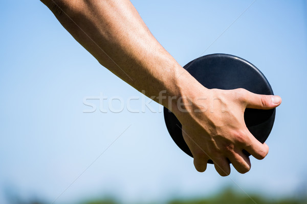 Close-up of hand holding a discus Stock photo © wavebreak_media