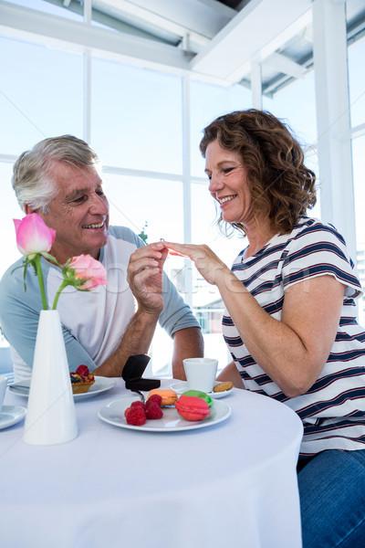 Happy man gifting ring to woman Stock photo © wavebreak_media