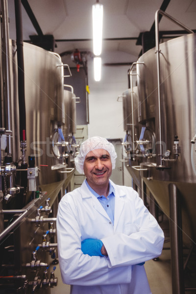 Smiling manufacturer standing at brewery Stock photo © wavebreak_media