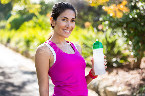 Smiling jogger drinking water while taking a break Stock photo © wavebreak_media