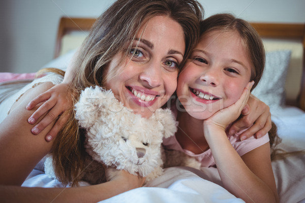 Mother lying with daughter on bed Stock photo © wavebreak_media