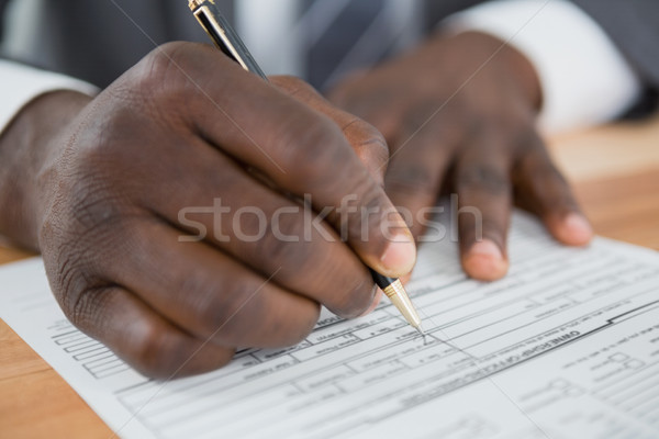 Hands of a man signing document Stock photo © wavebreak_media