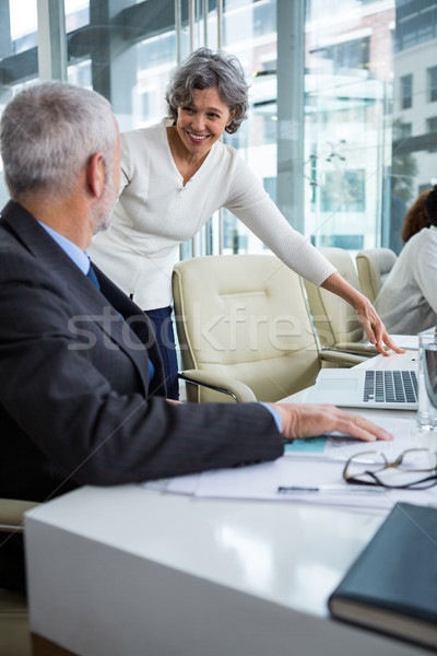 Businesspeople interacting with each other Stock photo © wavebreak_media