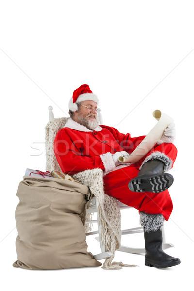 Kerstman lezing christmas lijst scroll Stockfoto © wavebreak_media