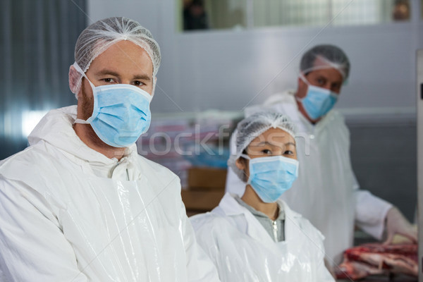 Butchers in protective workwear at meat factory Stock photo © wavebreak_media