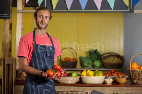 Portrait of male staff holding fresh tomatoes in organic section Stock photo © wavebreak_media