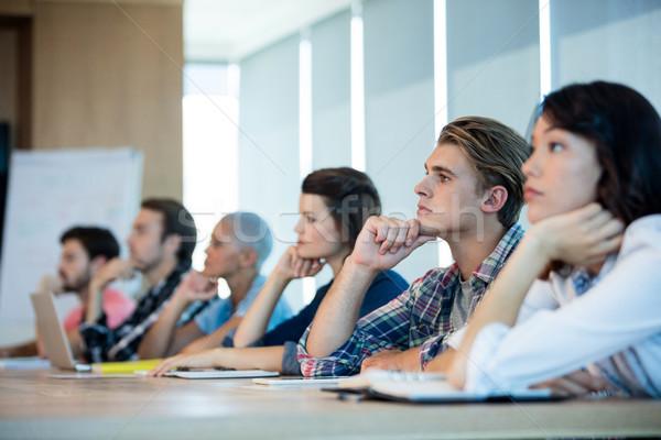Criador equipe de negócios escuta reunião sala de conferência escritório Foto stock © wavebreak_media