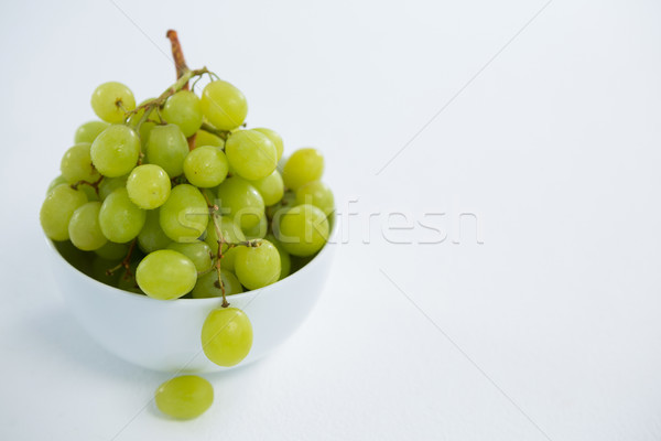 Close-up of green bunch of grapes in bowl Stock photo © wavebreak_media