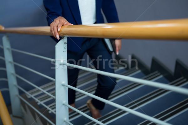 Empresária diário escalada passos mulher empresário Foto stock © wavebreak_media