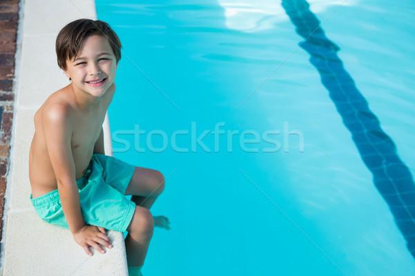 Smiling boy sitting at poolside Stock photo © wavebreak_media