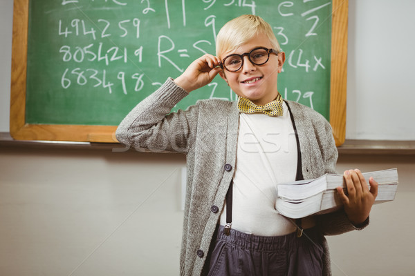 Smiling pupil dressed up as teacher holding books  Stock photo © wavebreak_media