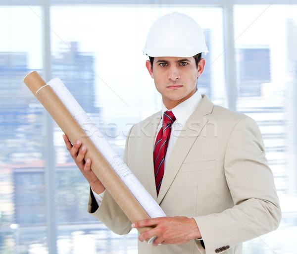 Handsome architect holding a blueprint   Stock photo © wavebreak_media