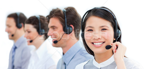 Portrait of smiling customer service agents working in a call ce Stock photo © wavebreak_media