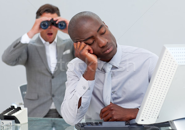 Asleep businessman annoyed by a man looking through binoculars Stock photo © wavebreak_media