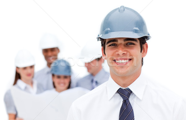 Stock photo: Focus on an architect wearing a hardhat against a white backgrou
