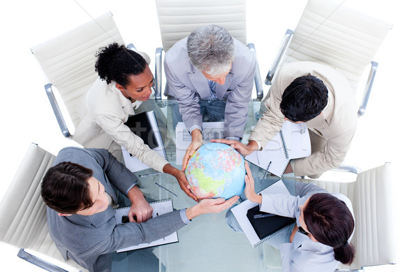 Serious international business team holding a terrestrial globe Stock photo © wavebreak_media