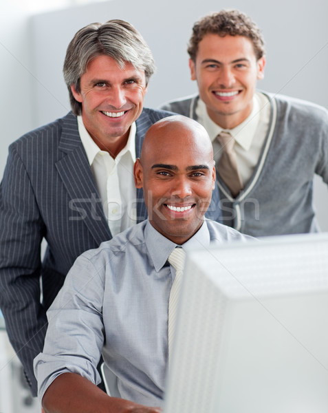 Self-assured business partners working at a computer together Stock photo © wavebreak_media