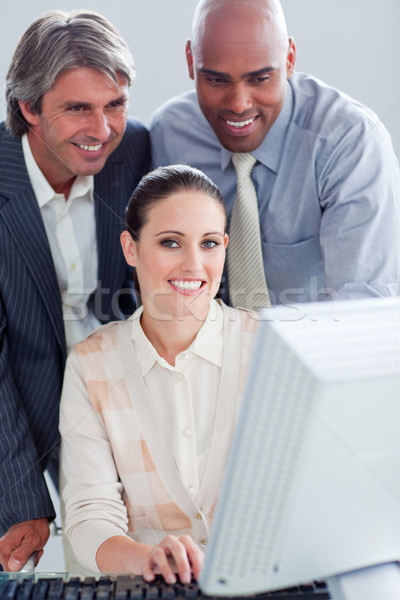 Portrait of a businesswoman and her colleagues working at a comp Stock photo © wavebreak_media