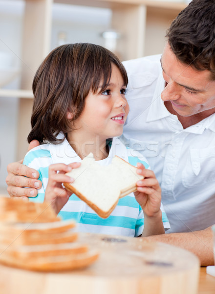 Adorable little boy and his father eating bread Stock photo © wavebreak_media
