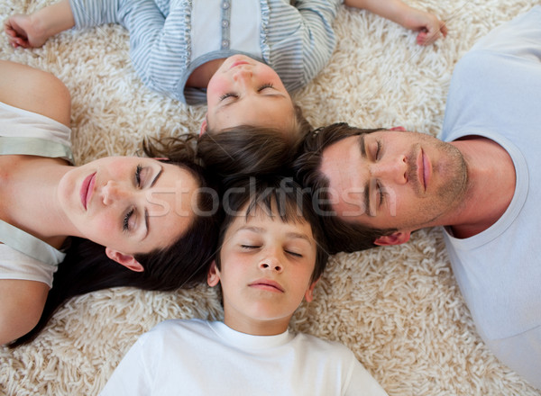 Family sleeping on the floor with heads together Stock photo © wavebreak_media