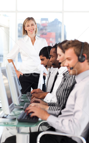 Cheerful female leader with a team on a call center Stock photo © wavebreak_media