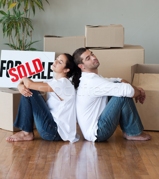 Happy young couple moving house relaxing on the floor Stock photo © wavebreak_media