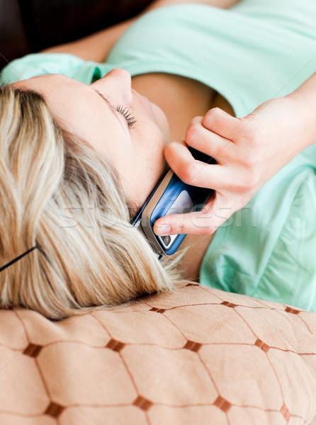 Unwind woman lies on sofa and phoning Stock photo © wavebreak_media