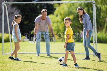 Lively family playing soccer Stock photo © wavebreak_media