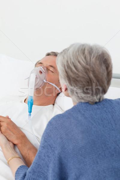 Old women taking care of her husband at home Stock photo © wavebreak_media