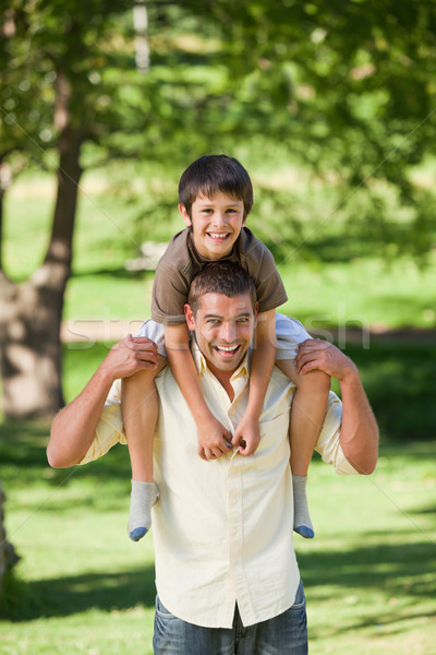 Jóképű férfi fiú háton mosoly szeretet tájkép Stock fotó © wavebreak_media