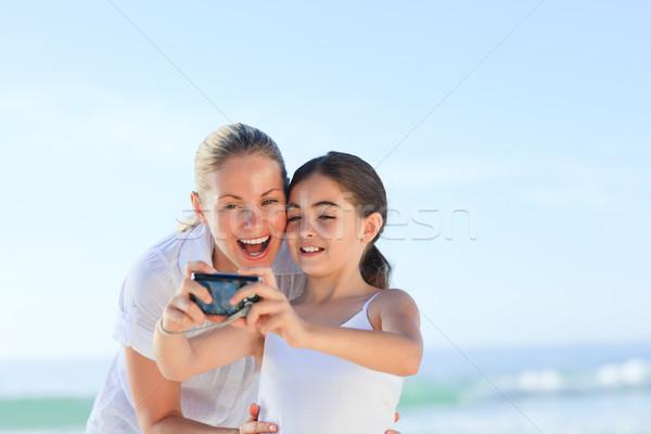 Zdjęcia stock: Portret · matka · córka · plaży · niebo · wody