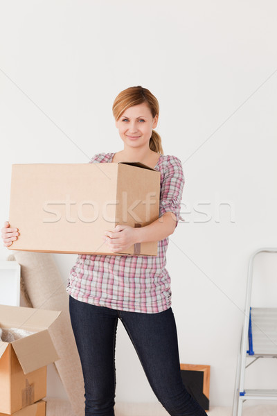 Blonde woman carrying cardboard boxes Stock photo © wavebreak_media