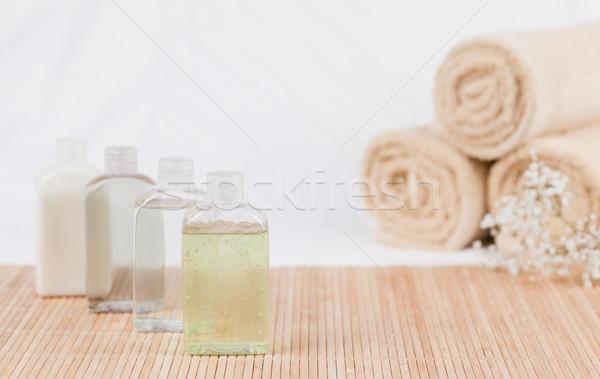 Masszázsolaj törölközők virág üveg csoport olaj Stock fotó © wavebreak_media