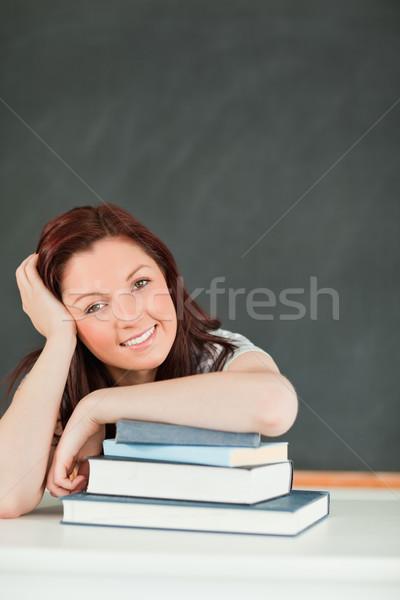 Jeunes étudiant avant-bras livres classe école Photo stock © wavebreak_media