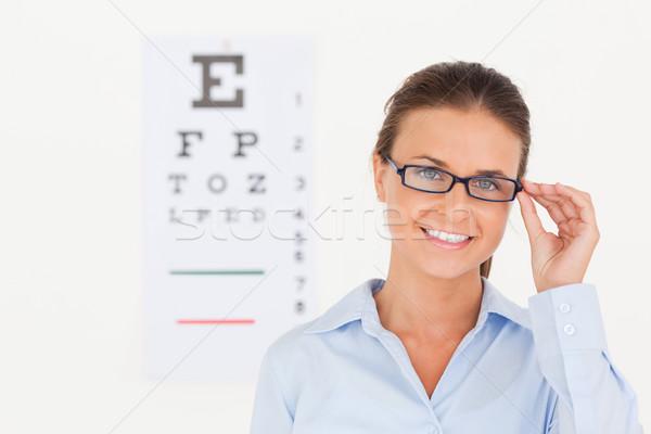 Di bell'aspetto occhi specialista indossare occhiali guardando Foto d'archivio © wavebreak_media