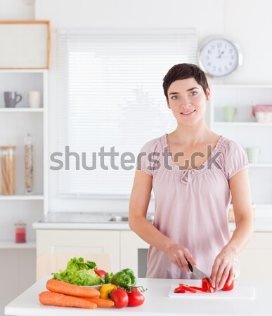 Cute Woman sitting at a table with wine for lunch in a kitchen Stock photo © wavebreak_media