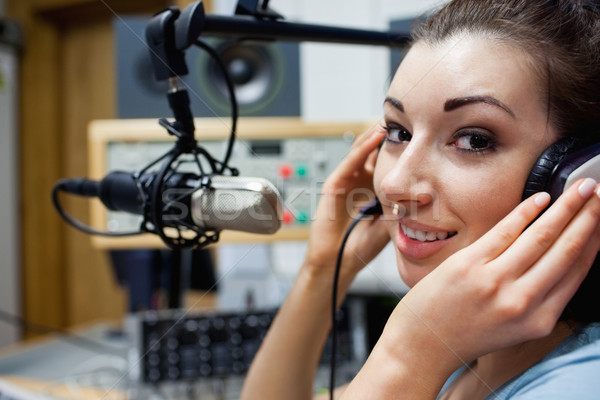 Close up of a young radio host posing in a station Stock photo © wavebreak_media