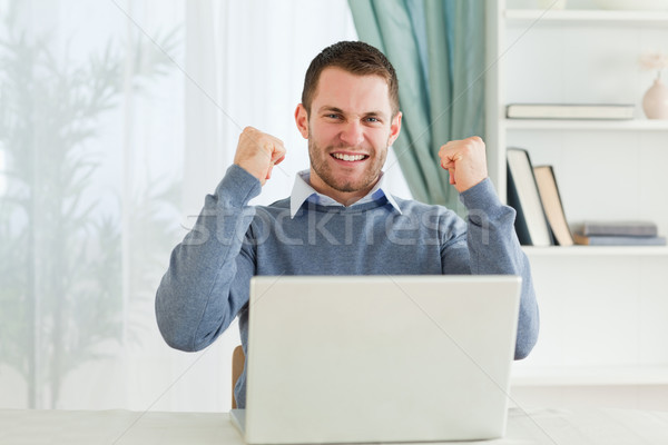 Young businessman celebrating success in his homeoffice Stock photo © wavebreak_media