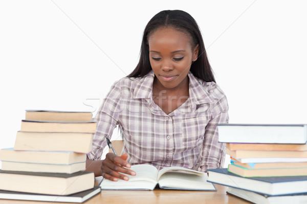 Young woman enjoying a novel against a white background Stock photo © wavebreak_media