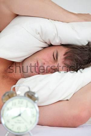 Bell'uomo dormire camera da letto casa faccia sexy Foto d'archivio © wavebreak_media