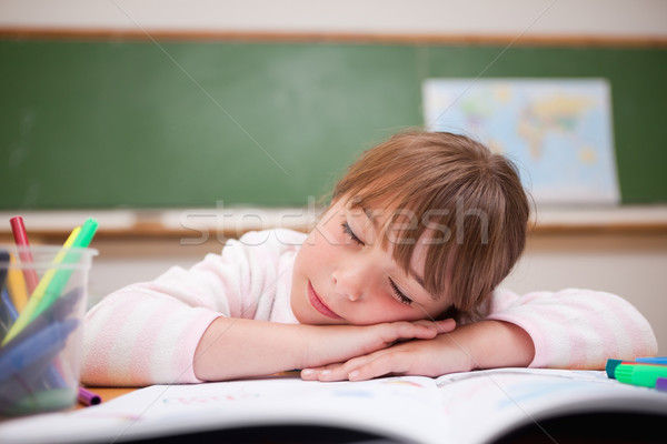 Schoolgirl sleeping on a desk in a classroom Stock photo © wavebreak_media
